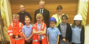 Network Rail's Dan Partridge, Charles Varey and Tracey Young with Duffryn Junior School pupils