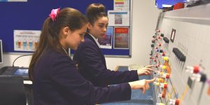 Caitlin and Sanel learn to operate a railway using Network Rail's signaller simulating equipment